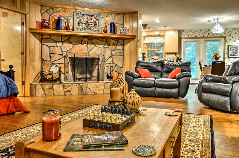 Snuggle up by the warmth of the stone fireplace at this vacation rental home.
