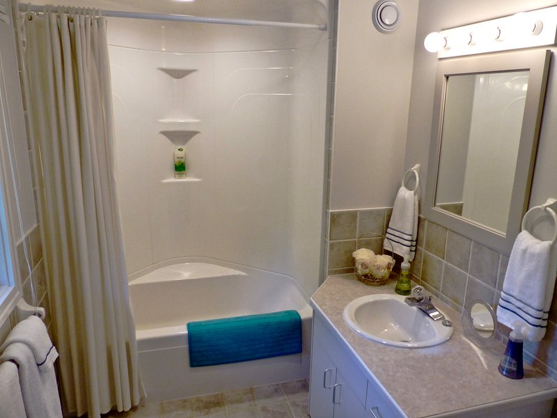 Full ensuite with tub-shower combo. Luxious towels and personal care products.