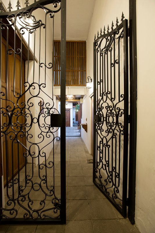 As you enter our main door, you will encounter a beautiful wrought iron gate that provides protectio