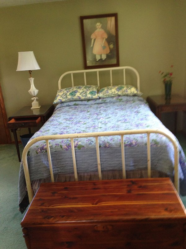 Vintage furnishings, art, lamps, fabrics underscore the modern amenities and cozy comforts