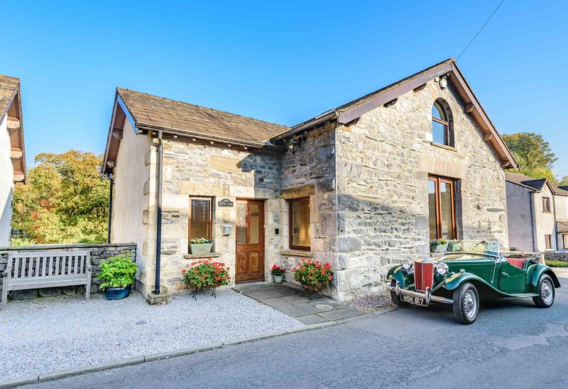 Stone detached property ideally located on quiet lane on fringe of the village.