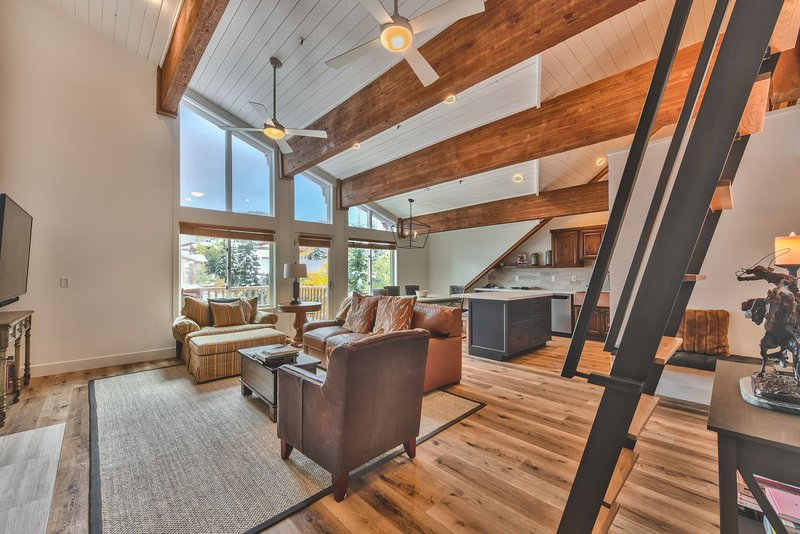 Completely Renovated Black Bear Penthouse A - Entry into Living Room, Kitchen and Dining with Beautiful Hardwood Floors Throughout