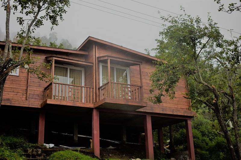 We provide luxury wood house service with awesome mountain view, 24hr water heater, camp firing.....