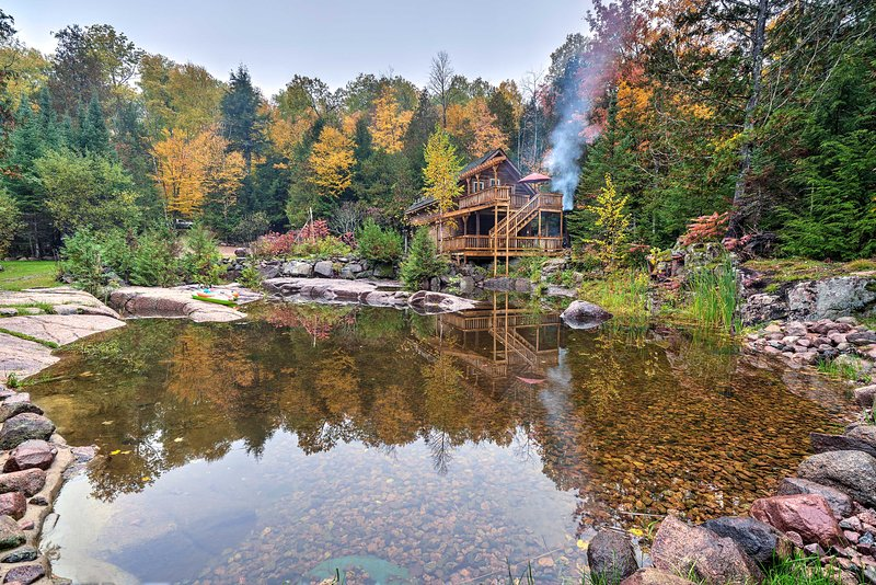This home is surrounded by forest and 600 feet of river frontage.