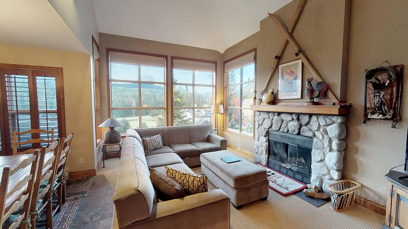 Living room w/ wood-burning fireplace and cable Tv