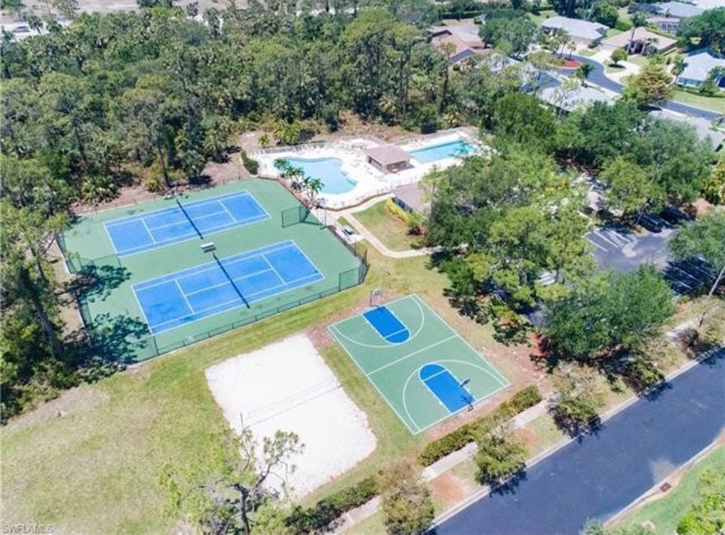 Ariel view community pools, clubhouse, courts and playground