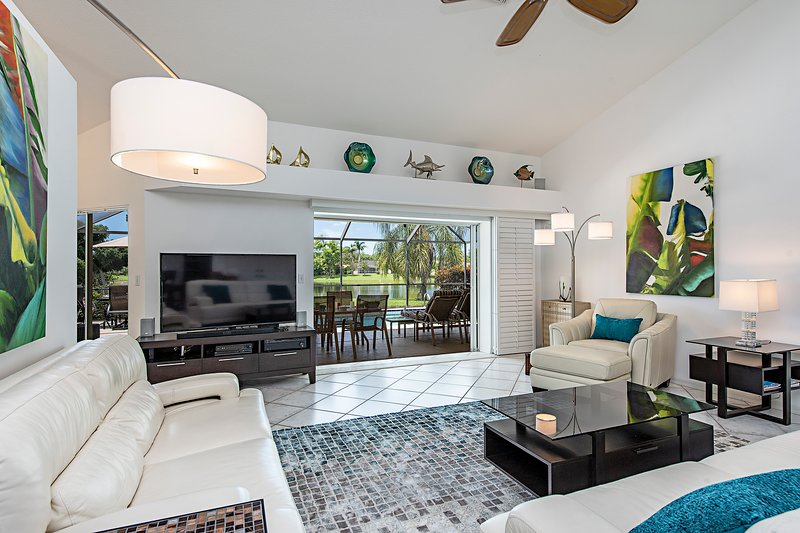 Private lakefront view inside modern but cozy living room 60'HDTV real leather