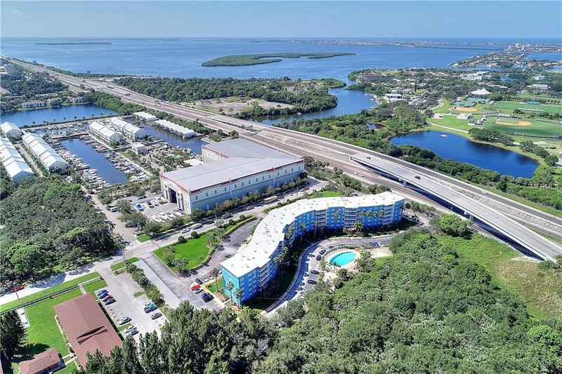 Aerial view of condo building and nearby area in south St. Petersburg on Tampa Bay