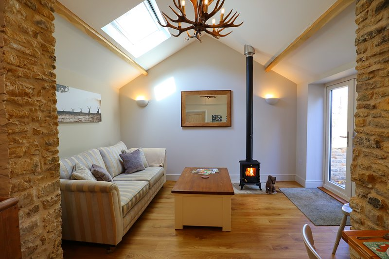 The light filled living area with super comfy sofa - perfect for curling up in front of the fire.