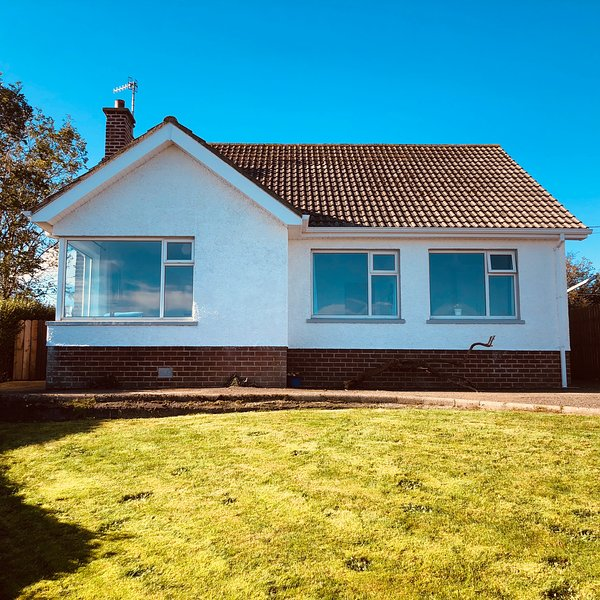 Three bedroom bungalow with fabulous sea views easy walking distance from the beach and the village