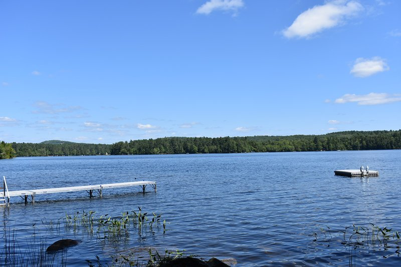 View of lake with dock and float