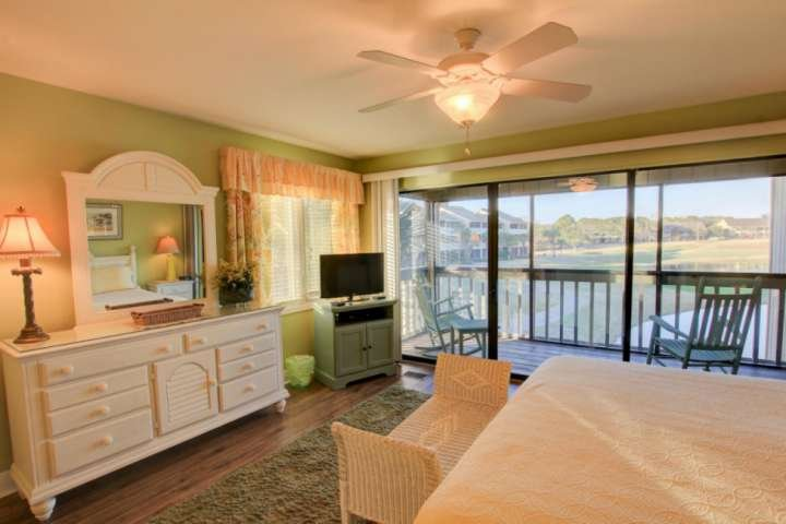 Enjoy the beautiful lake views from the master bedroom with king sized bed.