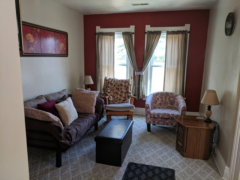 Upper living room. The futon converts into a lounge or single bed