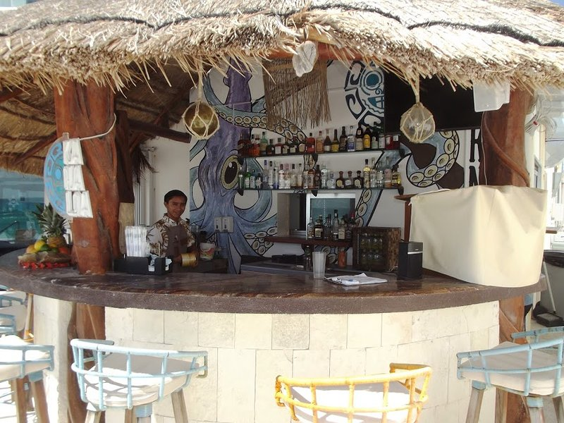 contiki bar next to restaurant and lower pool