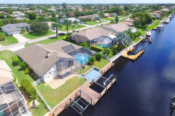 Enjoy your own little slice of paradise in this beautiful Southwest Cape Coral pool home located on a Gulf access canal.
