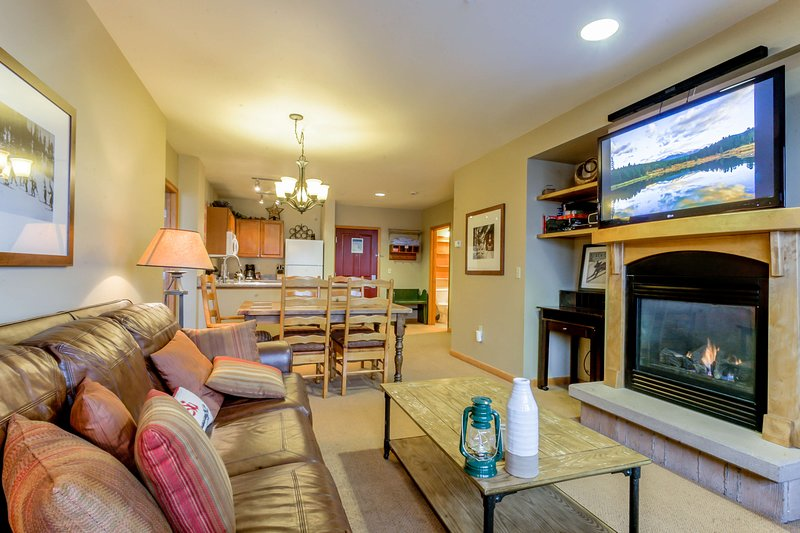 Get warm and snuggly next to the fireplace while the flat screen TV plays