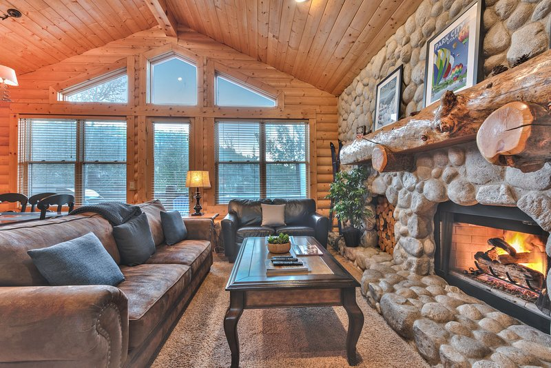Great Room with Stone Fireplace, Dining Area, and Deck with Private Hot Tub and BBQ