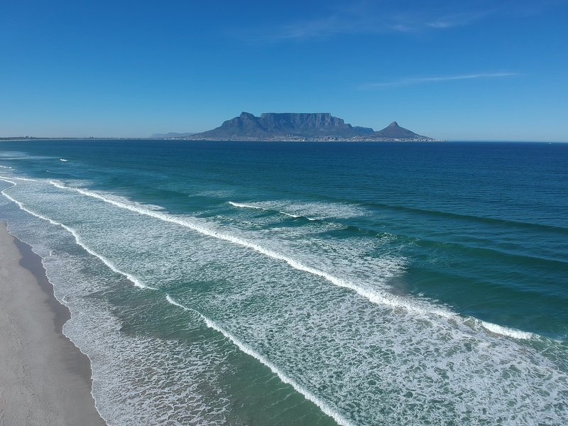 Arial shot of the coastline with magnificent Table Mountain in the background.