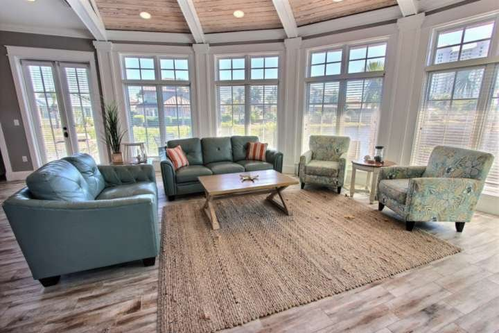 Lake front living room with hardwood floors and seating for 7