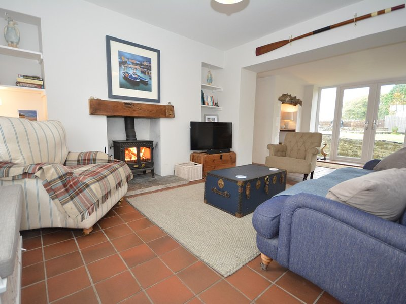 Beautiful lounge with a cosy wood burner