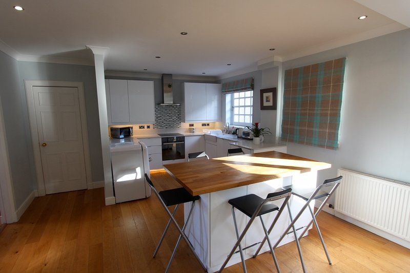 enter into the open plan kitchen, dining and relaxing area