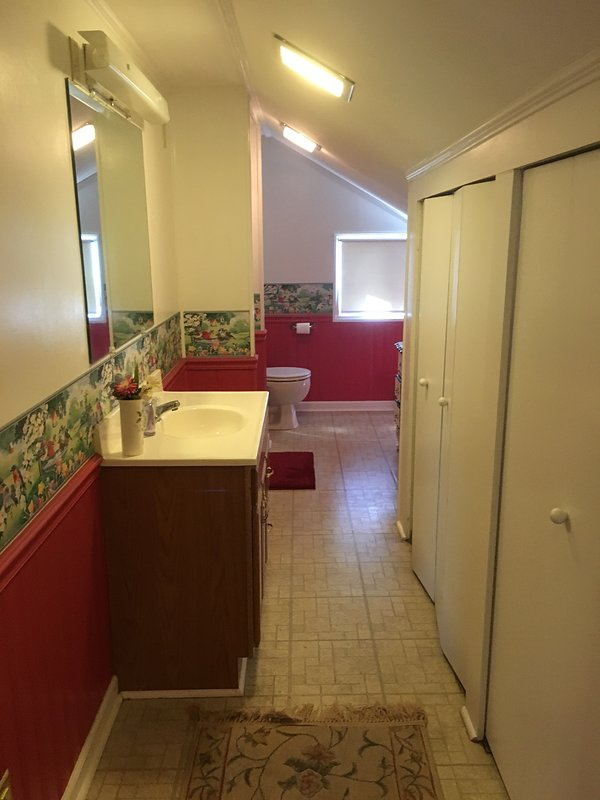 The upstairs bathroom features a separate shower and plenty of space.