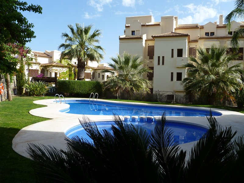 Communal swimming pool and gardens.