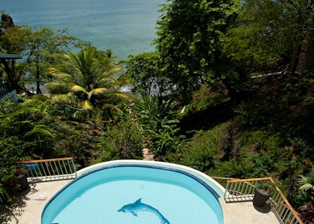 From Casa Colibri, it's just steps down to the sandy beach