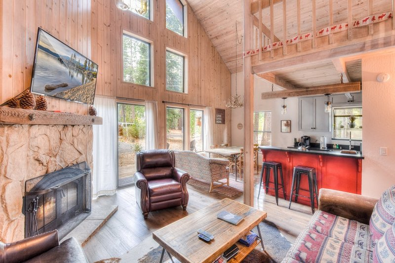 The living room features a wood fireplace and large flatscreen.