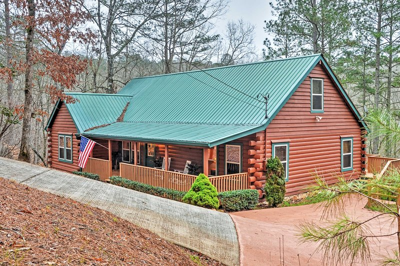 You'll love this Ellijay vacation rental home's authentic log cabin exterior!