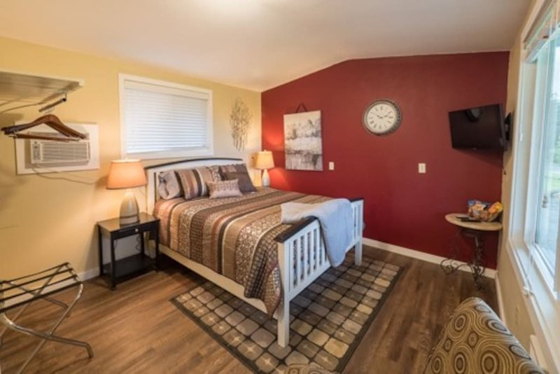 Queen bed with a 32' smart tv