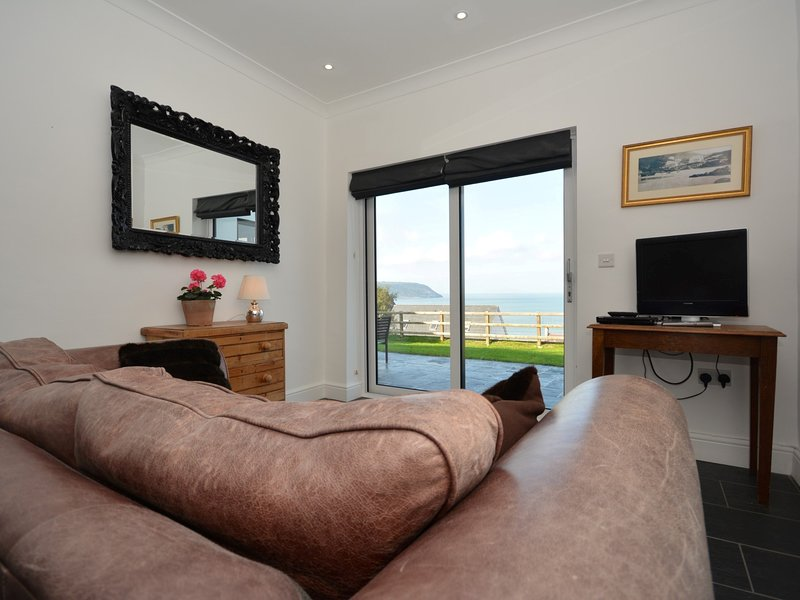 Most rooms with sea views to enjoy like the second lounge leading to the kitchen