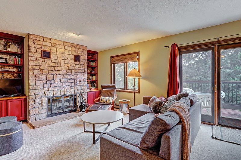 SkyRun Property - 'Trappeur 3' - Relaxing living room with a wood burning fireplace.