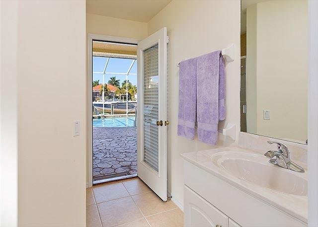 Third bathroom with cabana door to the pool