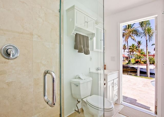 Second full bathroom with a cabana door to the pool