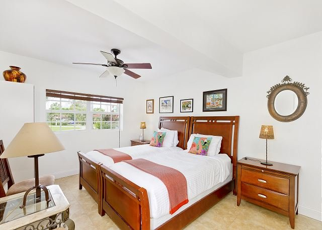 Fourth bedroom with professionally pressed linens