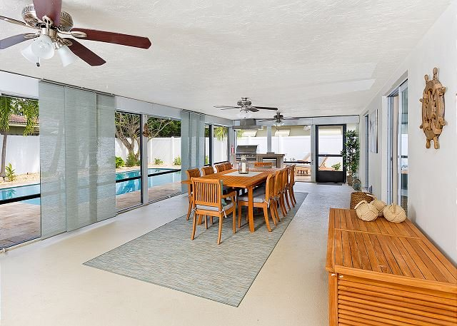 Screened-in Florida room with BBQ and fridge