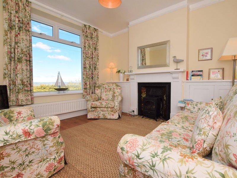 The lounge area boasting fabulous sea views and a Smart TV