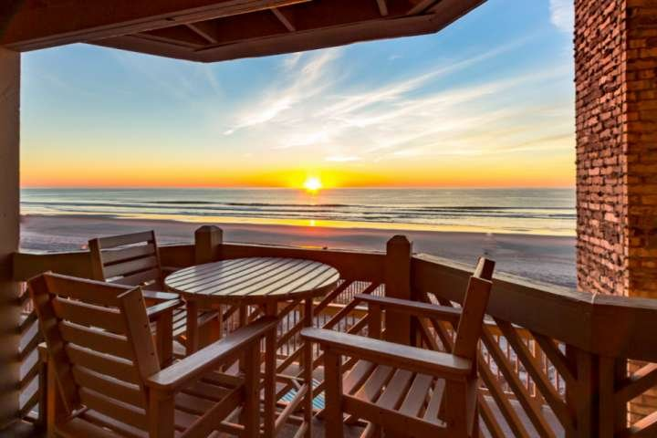Enjoy sunrise and morning coffee in this oceanfront condo