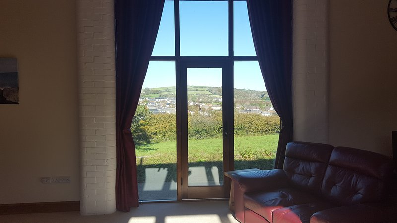 The view from the lounge over the village and surrounding hills.