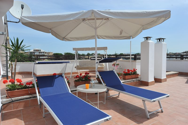 View of the terrace of 100mt q, where it is fantastic to be able to relax on the sunbeds at the Roman Polentino
