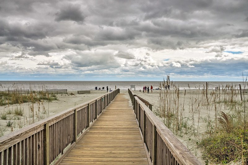 The beach is just steps away via the private boardwalk.