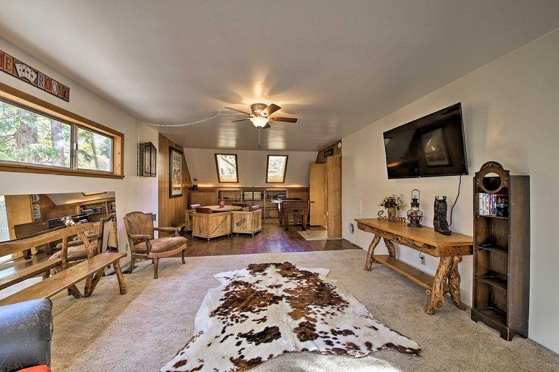 Rustic-inspired furnishings line the game room at 'HewLanders Hideaway!'
