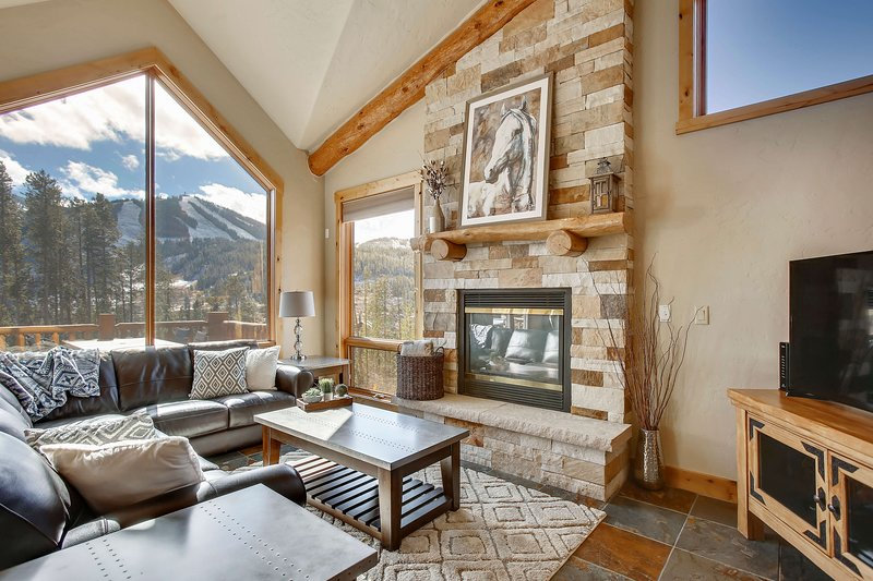 Relax in awe beside the gas fireplace and incredible mountain views