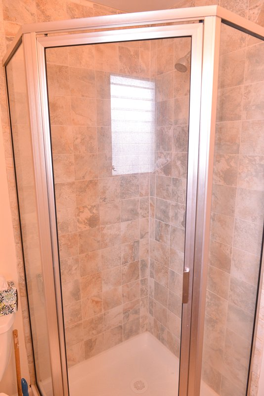 Walk in shower with detachable shower head for easy sand clean up!