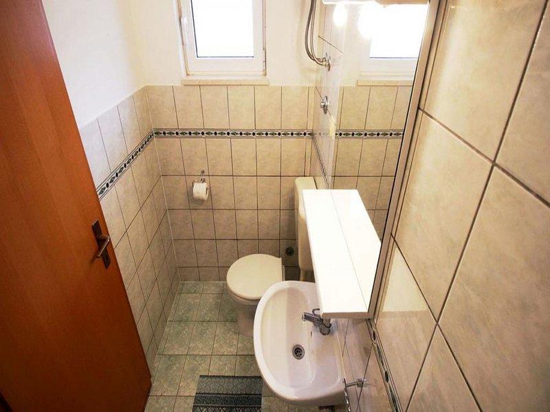 SA2 (3): banheiro com vaso sanitário