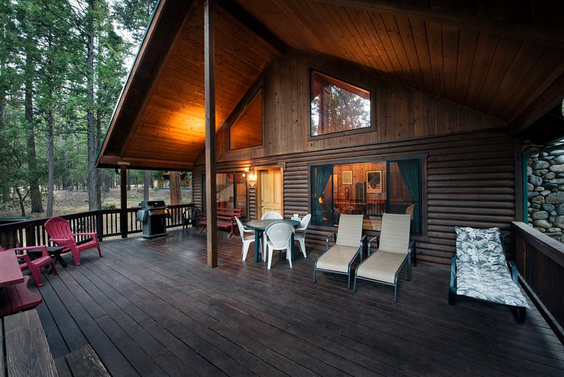 Front of cabin and its relaxing wood covered deck for all year-round BBQ experience.