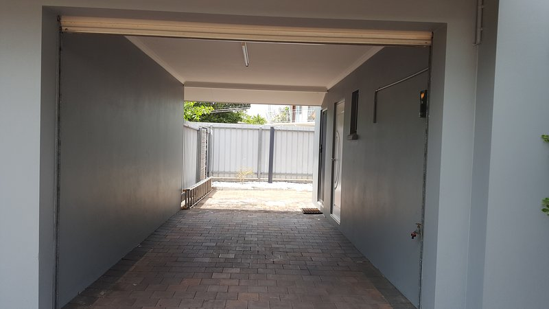 Townhouse - Lock-up Carport (2.6m wide, 2.1m high at entrance, and 10m deep into back courtyard)