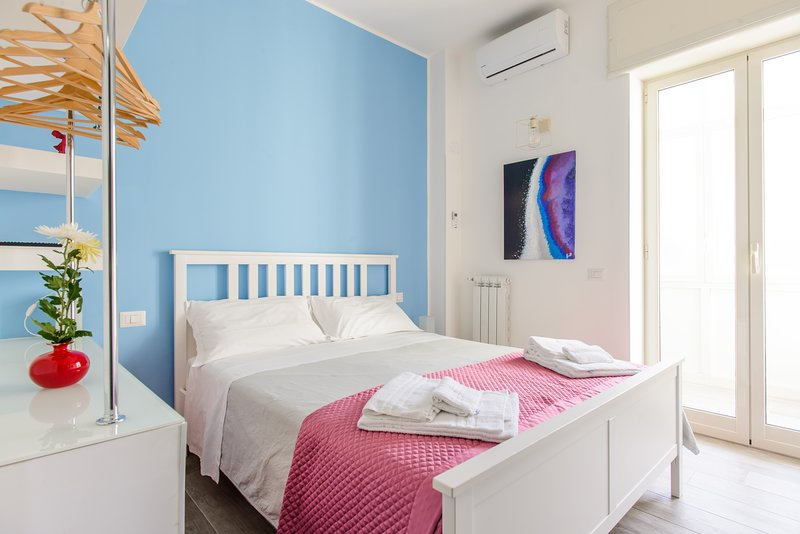 Spacious bedroom with veranda access, bright, with multimedia TV and air conditioning