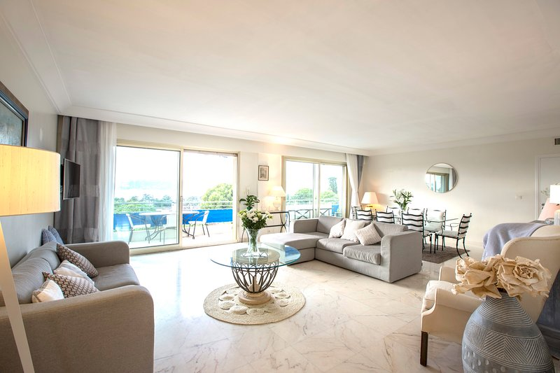 The living area has two large sofas, perfect for unwinding after a busy day with panoramic views